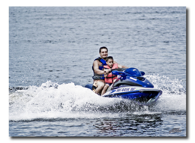My grandson and son-in-law out for a ride on Lake Harvey in Northwood, NH.