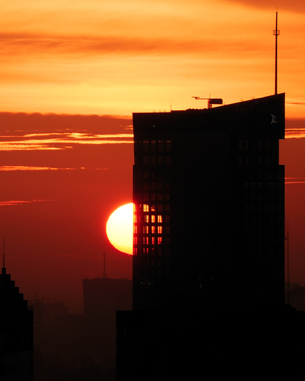 Sunset partially through office tower windows, Jakarta, 05Jan08.