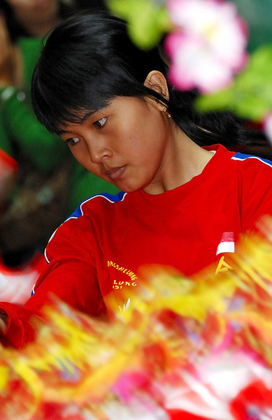 Girl as part of the Dragon Dance, Chinese New Year, Jakarta, 09Feb08