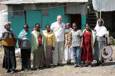 American team mission leader, Brad Nelson, gets a photo with some of the meal participants.