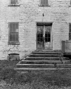 The well-kept exterior of a very old store/tavern in Hope, Missouri.  Across the road was a restored 19th century mill.