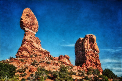 Balance Rock at Arches National Park.  With the sun behind, the rocks take on a golden hue.