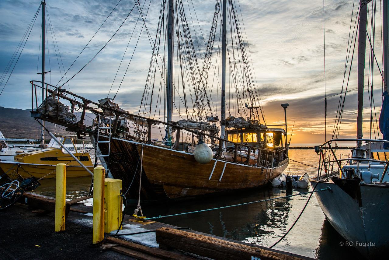 Sailboat docked at Kaunakakai Ferry Terminal at sunrise