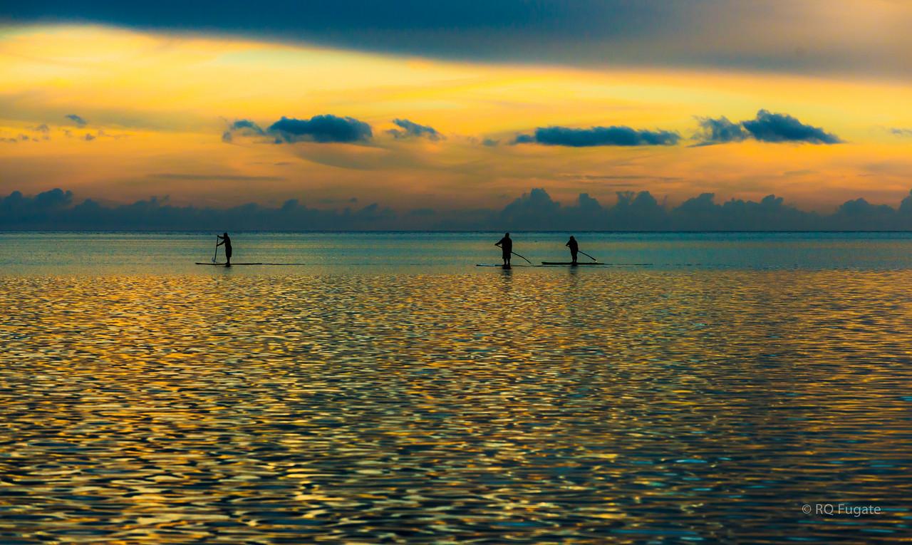 Paddlers at sunset