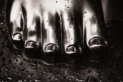 "Closeup of the right foot to Fernando Botero's ""Adam."""