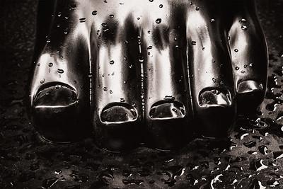 "Closeup of the left foot to Fernando Botero's ""Adam."""