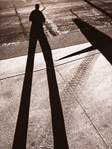 My shadow on a street in Port Townsend, WA.