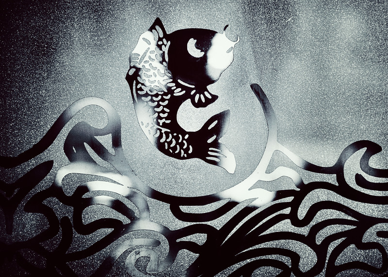 A fish jumping out of water window graphic for a Chinatown restaurant.