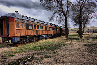 A couple of Chicago, Milwaukee & St. Paul passenger cars in need of a paint job in Nevada City.