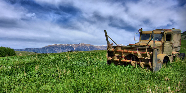 A vintage snowthrower along Jackson Creek Road. The Bridger Mountains in the background.
