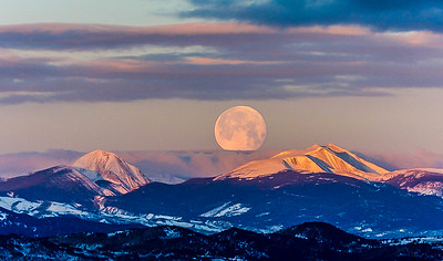Huge moon on a frozen morning over the Pintler Mountains