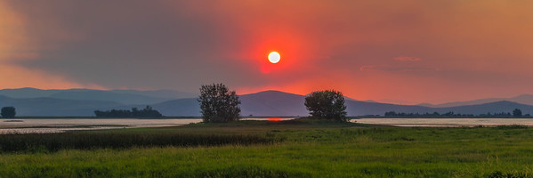 A smoky sunset over NInepipe reservoir.