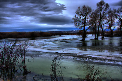 Ice flows under the Madison River near Three Forks.