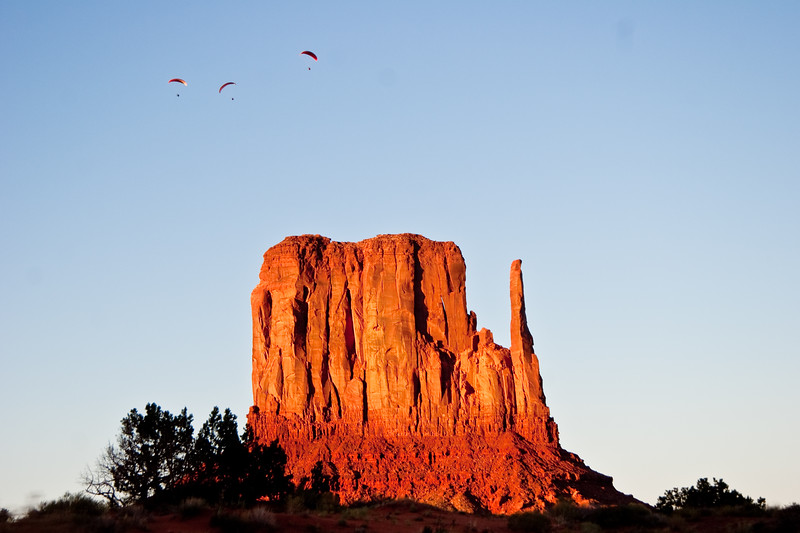 Powered paragliders over West Mitten at sunset