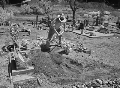 Ken Perez repairing a grave in the cemetery at Albuquerque, New Mexico.