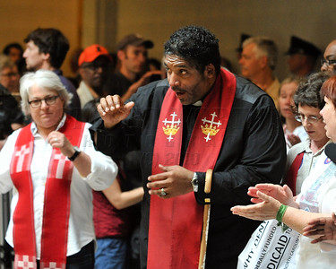 North Carolina NAACP President William Barber addresses those who gathered inside the rotunda of the North Carolina General Assembly Bulding. People gathered in the Halifax Mall in Downtown Raleigh on June 24, 2013 to protest the policies and laws proposed and passed by the North Carolina State General Assembly.