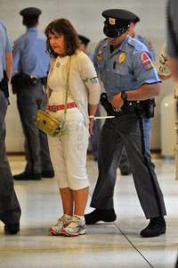 A Raleigh Police Officer arrests a protester inside the North Carolina General Assembly Building. People gathered in the Halifax Mall in Downtown Raleigh on June 24, 2013 to protest the policies and laws proposed and passed by the North Carolina State General Assembly.