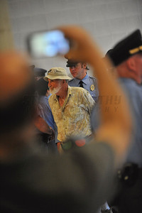 A Raleigh Police Officer arrests a protester inside the North Carolina General Assembly Building. People gathered in the Halifax Mall in Downtown Raleigh on June 24, 2013 to protest the policies and laws proposed and passed by the North Carolina State General Assembly. 120 were arrested.
