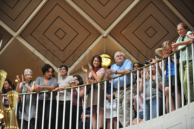 People gather on the top floor of the North Carolina General Assembly to watch the volunteers sing and be arrested. People gathered in the Halifax Mall in Downtown Raleigh on June 24, 2013 to protest the policies and laws proposed and passed by the North Carolina State General Assembly.