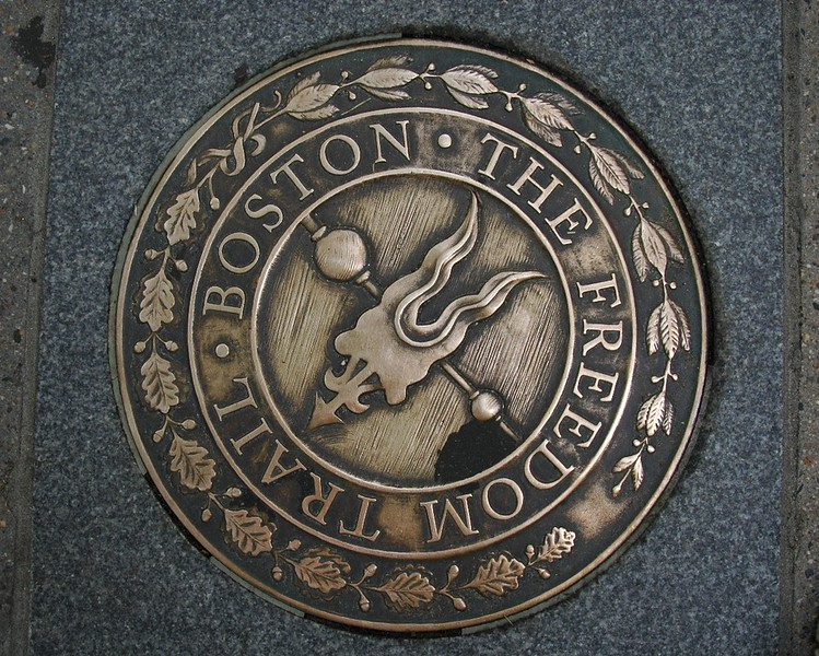 "A ""Freedom Trail"" Marker on the Street of Boston"