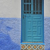 One of the many colourful entrances in Chefchaouen.