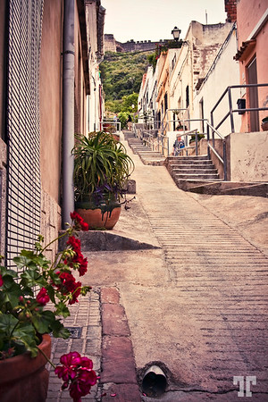 """23 May 09<br /> <br /> Another street in Sagunto, Spain<br /> <br /> - In the background you can see the Sagunto Castle, one of the biggest castles in Spain (now, mostly ruins)<br /> (more details to see on X3)<br /> <br /> From Internet search: <br /> """"Sagunto Castle is one of the 2 most important monuments in Valencia province, between the 3 most important monuments in Comunidad Valenciana and between the 66 most important monuments in Spain"""" andalucia"""