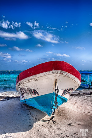 Fishing boat resting on the beach - Puerto Morelos, Mexico