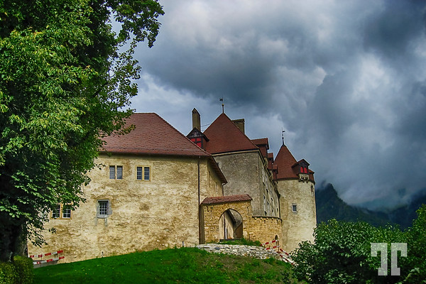 Old castle in Gruyere (Gruyères), Switzerland<br /> <br /> I took this photo in 2007, with my first digital camera a canon PS, during a one day trip to Gruyere - it was a rainy, cloudy, dark day.<br /> <br /> It's a beautiful medieval town, where they make the famous swiss cheese.