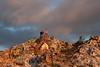 Spray painting quarts rocks on Bell Mountain