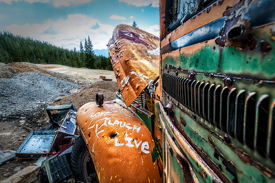 A bus that has seen better days, but which still bears the message of its former occupants.  At Leadville, Colorado