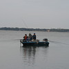 Crappie fishermen.  They must have had about 20 poles around the boat.