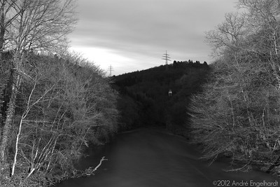 This is a 30 second exposure way past sundown. The only available light were some big sodium vapor lamps behind me (see next photo) which colored the original photo almost completely orange, so B/W it is!