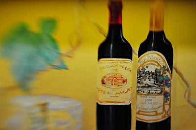 This is a picture of my kitchen wall, actually part of the backsplash.  An artist named Mary Page who now lives in Peachtree City, GA painted several frescos around my kitchen. These particular bottles of wine are two of the three painted there.  The Chateau Margaux is in honor of where we stayed in Bordeaux when we went.  The 1994 Far Niente is my favorite wine in the world.  The cheese is a wheel of Stilton, our favorite.