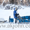 Close up of a musher in the 1,000 mile Yukon Quest during the start in Fairbanks Alaska