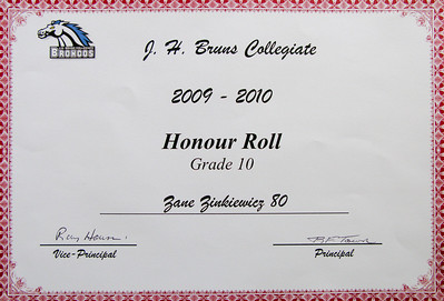 "Day 21: Honour Roll It would seem that I forgot to save my post last night? While we were at Zoya's Grad two days ago there was a message left on the answering machine saying that Zane was winning an award at the ceremony the following day.(today) I talked to Stacie and we figured it was either for Jazz Guitar or Electronics as he excelled in both. We didn't say anything to Zane about him getting an award and he was not impressed that we had to go sit through a ceremony for the second day in a row. He was complaining to his step-brothers about it and when I told them to get ready to go, to me also. I just told him it was an awards ceremony and Mom said we have to go, so we were going!  We all sat there as they went through the awards for each grade. When they finished grade 10 and didn't call his name for anything, I was confused?  Todays photo is of Zane's honour roll certificate. Zane is 16 and for the past three months he has been walking around in a fog. The only things that seem to matter were his text messages from girls, and the emails from them on his iPod touch. Let's just say there was a lot of, ""huh"" and ""what"" going on. Zane is a smart kid and made the honour roll all through grade school. Obviously, these smarts came from his Mother! Last year, his first year in high school, was the first time he didn't make it. We just figured, ""Well, it was a good run."" With the way he has been acting lately I'm not sure who was surprised more, him or us? He may have just squeaked in with exactly an 80% average, but he pulled it off! Congratulations Zane! You deserve it..."