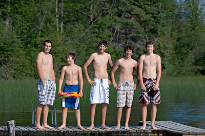 Day 49: The Morning Swim Here we have Brad Davis, Jarod Burnell, Kyle Davis, Zane Zinkiewicz & Kurtis Burnell all standing on the dock at Pritchad lake. Pretty much the only photo taken where they are standing still...