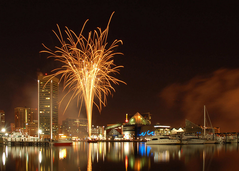 Happy New Year<br /> <br /> Baltimore's New Year's Inner Harbor Fireworks<br /> <br /> The New Year's fireworks were postponed on New Year's Eve because of poor weather. They were rescheduled for early New Year's evening. The wind was calm and the crowd was small and I was blessed with a great opportuninity to get a nice photograph.