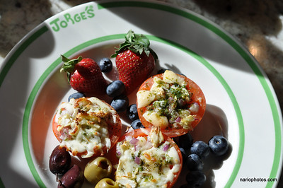 Any in-season berries will do just fine.  If you are not into berries or don't have any, you can try some greek calamata olives or jumbo queen olives stuffed with red pimentoes.  For nutritional content see original recipe.