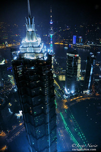 "We only show you 100% original photos taken by us for your pleasure.   Like this photo of the 88 floor Jin Mao skyscraper in Shanghai, China designed by the Chicago Architectural office of Skidmore, Owings & Merrill and home of the Cloud9 Bar. What's taller? The Music Room on the 93rd floor of the Park Hyatt Shanghai, located on floors 79-93 of the Shanghai World Financial Center across from it. That's where we took this and many photos of the Shanghai night skyline while sipping delicious concoctions and sampling the fine cuisine. Who says you can't mix work with pleasure?  ""Like Our Page"" for frequent updates.  Asia photo shoot"