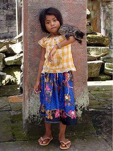 Cambodian Temple Girl with pet lemur