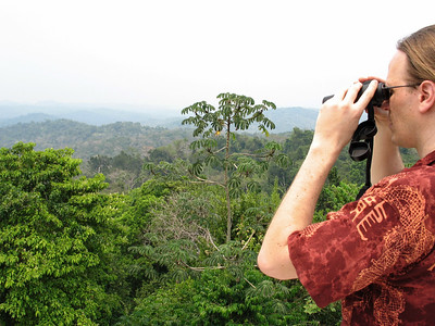 Dan surveys the view from the top of the grandest temple at Caracol, Caana. We are 140 feet up from the jungle floor.
