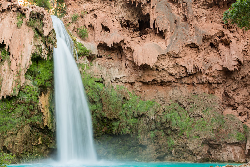 The travertine deposited by the water over thousands of years shows where the Havasu Falls waterfall poured over the cliff.