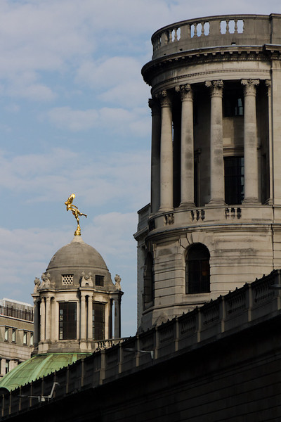 This golden statue of Shakespeare's Arial stands atop the Bank of England, over Tivoli Corner looking down Princes Street. She represents the spirit of the Bank with it's dealings being transmitted to all parts of the globe.