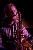 Brent Merchant playing the sax in the band Aqua Jones