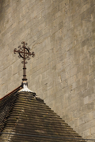 A cross on top of a building along the road to the Chichester Cathedral.