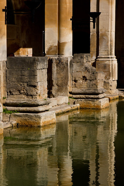 This is a picture of the original Roman bath at Bath. They built baths and a temple on the surrounding hills of Bath in the valley of the River Avon around hot springs. Much later, it became popular as a spa town during the Georgian era, which led to a major expansion that left Georgian architecture crafted from Bath Stone.