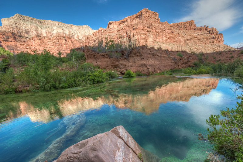 The canyon along Havasu Creek reflected in the creek.  The water is so clear you can see the bottom.