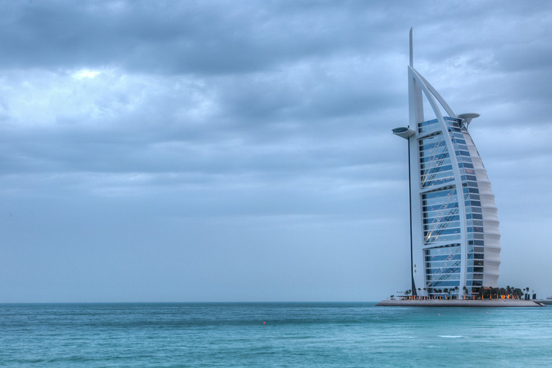 Burj Al Arab hotel sits on a man made island. So pretty in a gathering storm off the Arabian Gulf.