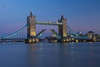 Tower Bridge at dusk. Here the bridge is opening for a ship to pass through.