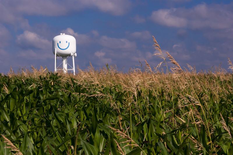 A water tank looks over several fields - and seems very pleased
